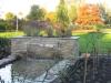 Tuin met vijver en waterpartij